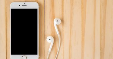 Podcast | Ehlers-Danlos News | Iphone and earbuds rest on table